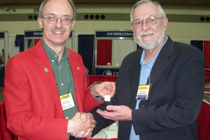 Third place award accepted by William Anderson from exhibit chairman Bryce Doxzon,